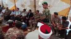 الأمير فيصل يقدم العزاء بالشهيد الطلافحة