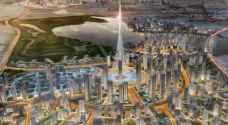 من سيبني أعلى برج بالعالم في خور دبي؟