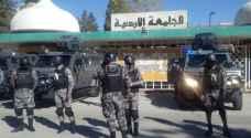 تعزيزات أمنية مكثفة بمحيط الأردنية والقبض على 14 من مثيري شغب..صور