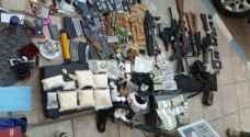 ضبط مخدرات وأسلحة بمداهمة أمنية .. تفاصيل