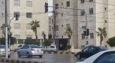 تعطل 20 اشارة ضوئية في عمان بسبب المنخفض .. صور