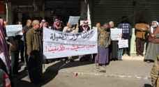 وقفة احتجاجية تضامنا مع حلب في الطفيلة.. صور