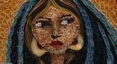 فنانو العراق يبرزون أزمة المهاجرين في لوحاتهم
