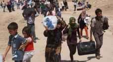 بغداد تنقل 1400 نازح عراقي من سوريا الى مخيم العلم