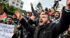 مسيرة 'عمالية' في غزة للمطالبة برفع الحصار ..صور