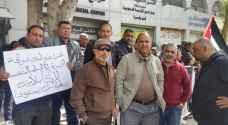 عمال 'مسك والجهد العالي للكوابل' يطالبون بأمن الوظيفي .. صور