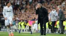 أوزيل يكشف سر تمزيق قميص ريال مدريد ورميه على مورينيو
