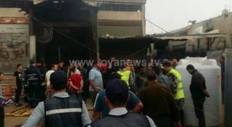 بالصور.. ٤ اصابات احدها خطرة بحريق محل تجاري في اربد