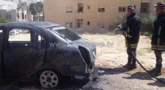 حريق مركبة في ضاحية الرشيد .. صور