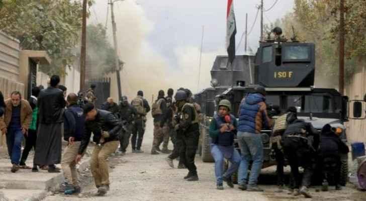 قوات حكومية عراقية في مواجهة مع تنظيم داعش في الموصل