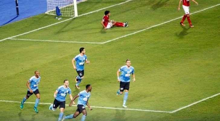 جانب من مباراة الفيصلي مع الأهلي المصري