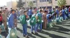 توزيع الحقائب المدرسية ومستلزماتها على اللاجئين السوريين
