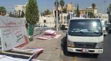 أمانة عمان تواصل حملتها لإزالة اللوحات الاعلانية المخالفة