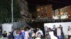 عمان: إخلاء بناية بعد انهيار أجزاء منها ..صور