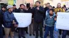 بالصور: هتافات ضد الملقي في الطفيلة ومطالب باسترداد مقدرات منهوبة