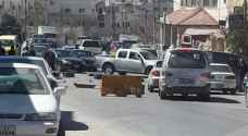 الأمن يتعامل مع أعمال شغب في خريبة السوق جنوب عمان ..صور