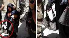 صور صادمة.. أم داعشية تفجر نفسها وطفلها في الموصل