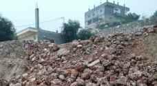 عجلون:غزارة مياه الأمطار تتسبب بانهيار جدران استنادية