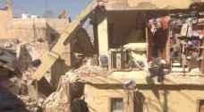 اخلاء عمارة في حي الحسين بالزرقاء