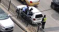بالصور.. الأمن ينقذون امرأة فقدت وعيها بشارع الملكة رانيا