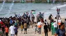 شهيد وعشرات حالات الاختناق في المسير البحري الـ 14