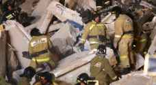 انتشال رضيع حيّاً من تحت أنقاض مبنى منهار في روسيا - فيديو