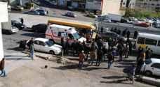 11 إصابة بحادث تصادم حافلتين طلاب وعمومي على مدخل السلط - صور