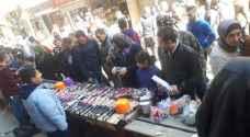 """الأردنيون يتفاعلون مع حملة """"#يلا_عالبلد"""" لدعم التجار المتضررين - فيديو وصور"""