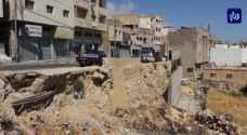 خلافات توقف أعمال إعادة بناء جدار استنادي في الطفيلة - فيديو