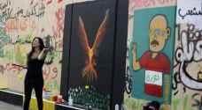 """رسوم غرافيتي """"الثورة"""" تجتاج أحياء وسط بيروت - صور"""