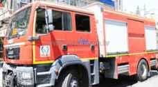 الدفاع المدني يخمد حريق مستودع في سحاب - فيديو