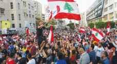 أف ب: مناصرون لحزب الله وحليفته أمل يهاجمون المتظاهرين في بيروت
