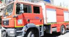 الدفاع المدني يخمد حريق محل دهان مركبات في عمان