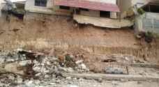 إخلاء 14 شقة سكنية إثر انهيار جدار استنادي لاحدى البنايات في الزرقاء.. فيديو وصور