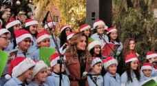 الملكة رانيا تشارك أهالي الفحيص الإحتفال بالأعياد المجيدة - صور
