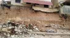 """""""طوارئ الأمانة"""" تتعامل مع انهيارات لعدد من أسوار المنازل في عمان"""