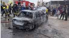 إخماد حريق مركبة في اربد - صور