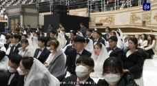 """زواج جماعي في كوريا يتحدى فيروس كورونا بـ """"الكمامات"""".. فيديو"""
