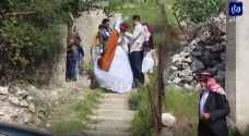 زفاف عروسين في زمن الكورونا بعجلون - فيديو