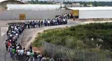 العمال الفلسطينيون يعودون إلى أعمالهم في الداخل المحتل