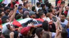الفلسطينيون يشيعون جثمان الشهيد الطفل قيسية - صور