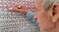 أب فلسطيني يرسم رزنامة من 365 خانة للقاء ابنه الأسير منذ 16 عاما