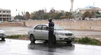 رجال الأمن يؤدون واجبهم رغم الظروف الجوية الصعبة