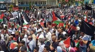 """الجالية الفلسطينية في بولنداً تنظم وقفةً احتجاجية ضدّ """"ورشة البحرين"""""""