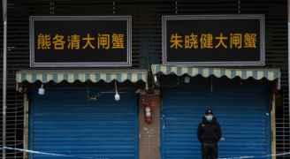 بورصة طوكيو تتراجع 3,3 بالمئة عند الإغلاق في أجواء القلق من كورونا