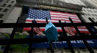 أمريكا تعيد فرض وضع الكمامة
