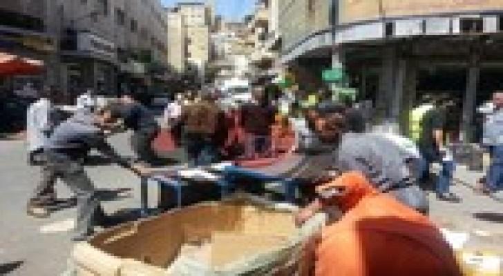 ايقاف 14 شخصا خلال حملة لإزالة بسطات وسط البلد