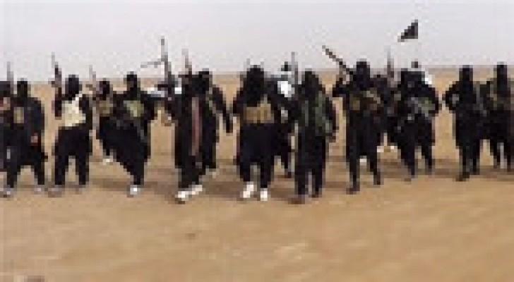 """الأناضول:  """"داعش"""" ينشر صور 21 مسيحيا مصريا بملابس الإعدام البرتقالية"""