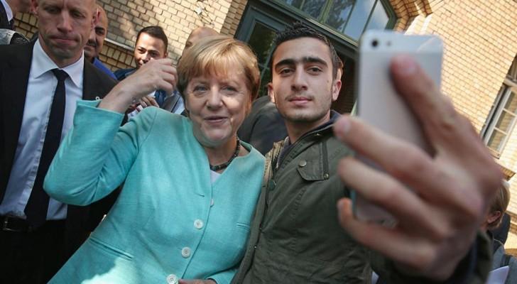 موداماني يلتقط سيلفي مع ميركل في برلين في سبتمبر 2015