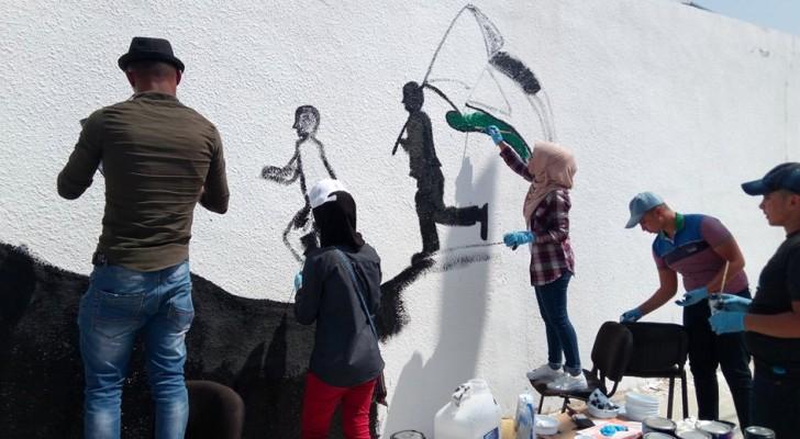 جانب من مبادرة أرسم فلسطين على جدران المخيم